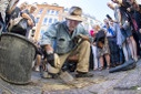 The German artist Gunter Demnig puts 3 Snublesten - Stumbling Stones - in front ...