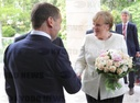 President Vladimir Putin meets with German Chancellor Angela Merkel
