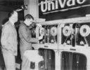 Photograph of a Univac computer being prepared to predict the winning horses.