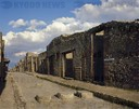 Italy. Pompeii. Street of Abundance, one of the main Decumanus of the city. In the foreground, a pedestrian crossing. UNESCO Wor