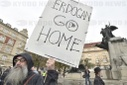 "another protest against Turkish invasion of Syria held in Prague, ""ERDOGAN GO HOME"" banner"