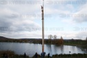 Setting up a 16 metre high wooden sculpture at the Hohenfeld reservoir