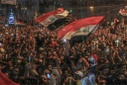 Protesters watch soccer team win against Iran in Baghdad