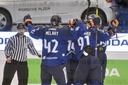 Finnish players celebrate the third goal