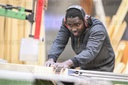 Refugee Omar Ceesay works as a carpenter