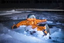 Aleksander Gamme tests out the survival suit that Boerge Ousland has taken with him on an expedition