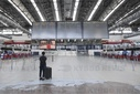 Vaclav Havel Airport Prague, only one passenger is seen in empty departure hall
