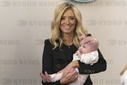 White House Press Secretary Kayleigh McEnany poses for photos with her baby Blake Avery Gilmartin at the White House