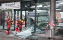 Articulated bus crashes into station building
