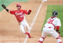 Kia Tigers'' Park Chan-ho slides into home