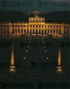 Schoenbrunn Palace (1690-1747) at night with the Gloriette-gallery in the background.