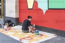 NY: Artists painting murals on plywood cover