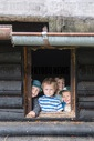 children in a former scout log house in woods