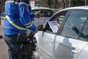 Coronavirus outbreak and quarantine. Road check conducted by the gendarmerie