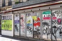 Posters indicate that a commercial space is for rent in the Montparnasse district..