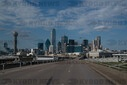 A road leading into downtown Dallas is empty of traffic during a spike in COVID-19