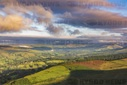 Vibrant colours at sunrise across the Peak District as seen from Higgor Tor above the beautiful village of Hathersage in Derbysh