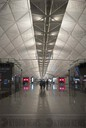 Empty gates and closed luxury shops at Hong Kong International Airport
