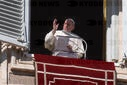 Pope Francis waves duirng his angelus
