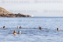 Swimmers brave the sea temperatures at Langland Bay near Swansea, Wales